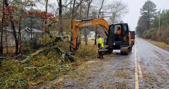 Crews work to clean up a downed tree on Monday, Dec. 16, 2019, in the 5700 block of Bellevue Road in Bossier Parish.