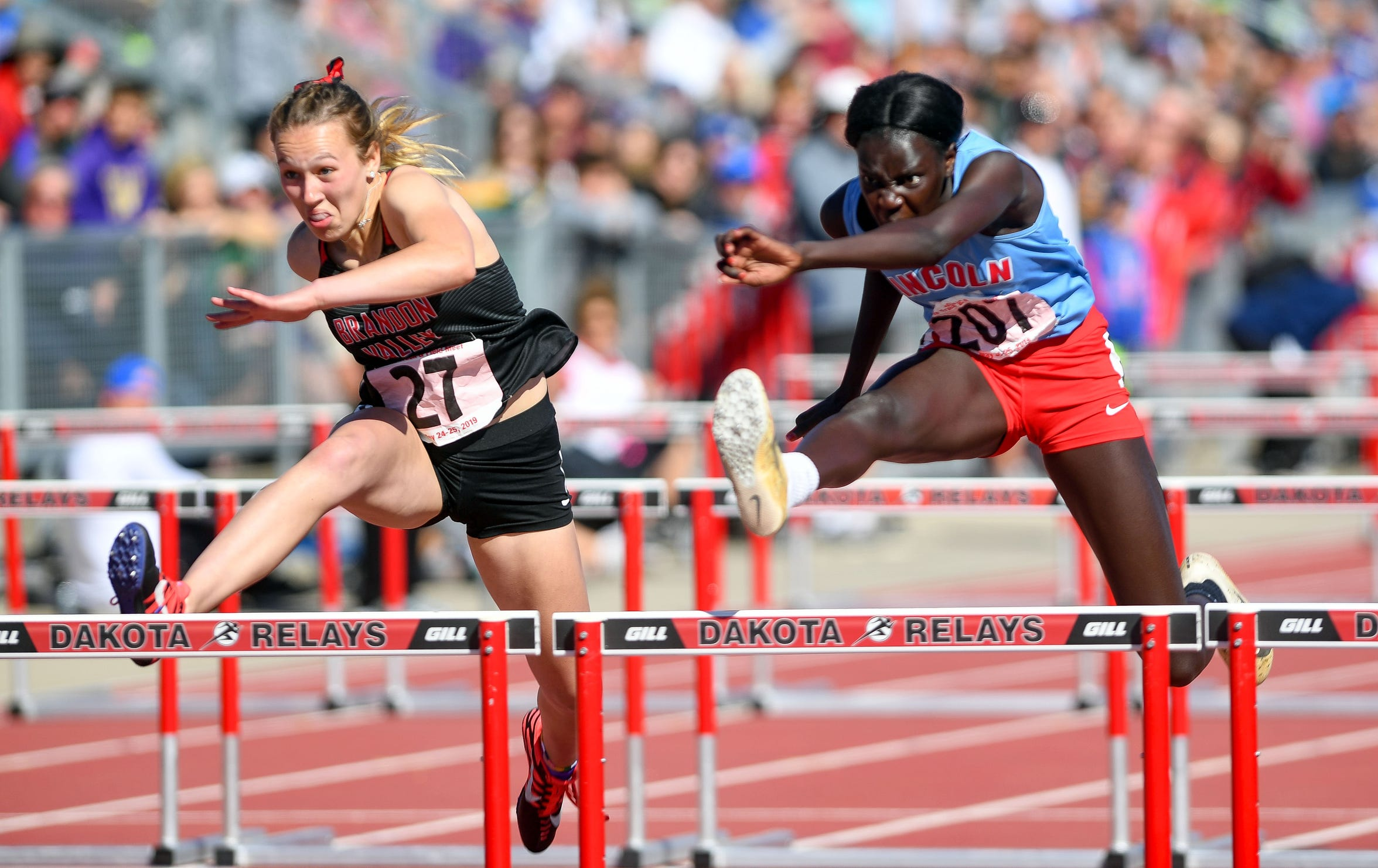 Brielle Dixon of Brandon Valley and Josephine Dal of Sioux Falls Lincoln leap over hurdles during the AA 100 meter hurdle race on the second day of the state high school track and field meet Saturday, May 25, 2019 at Howard Wood Field in Sioux Falls.