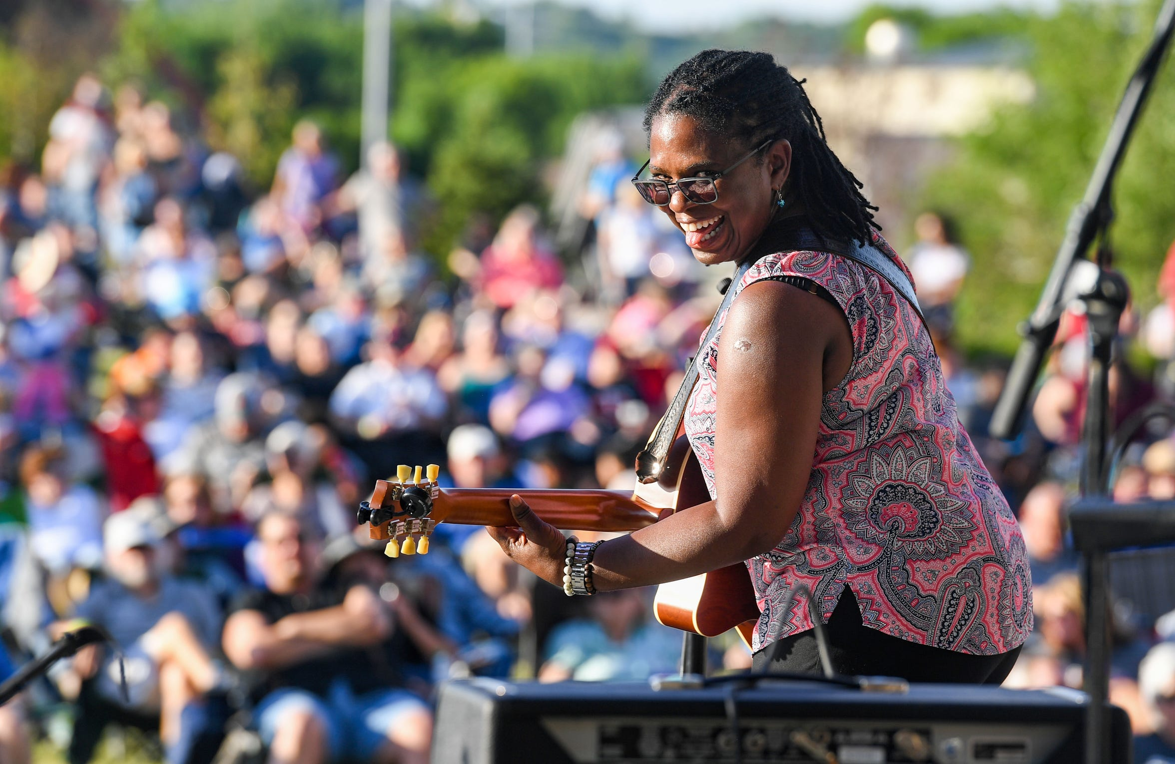Ruthie Foster looks back playfully at the band during her performance for opening night of Levitt at the Falls on Friday, June 14, 2019 in Sioux Falls.