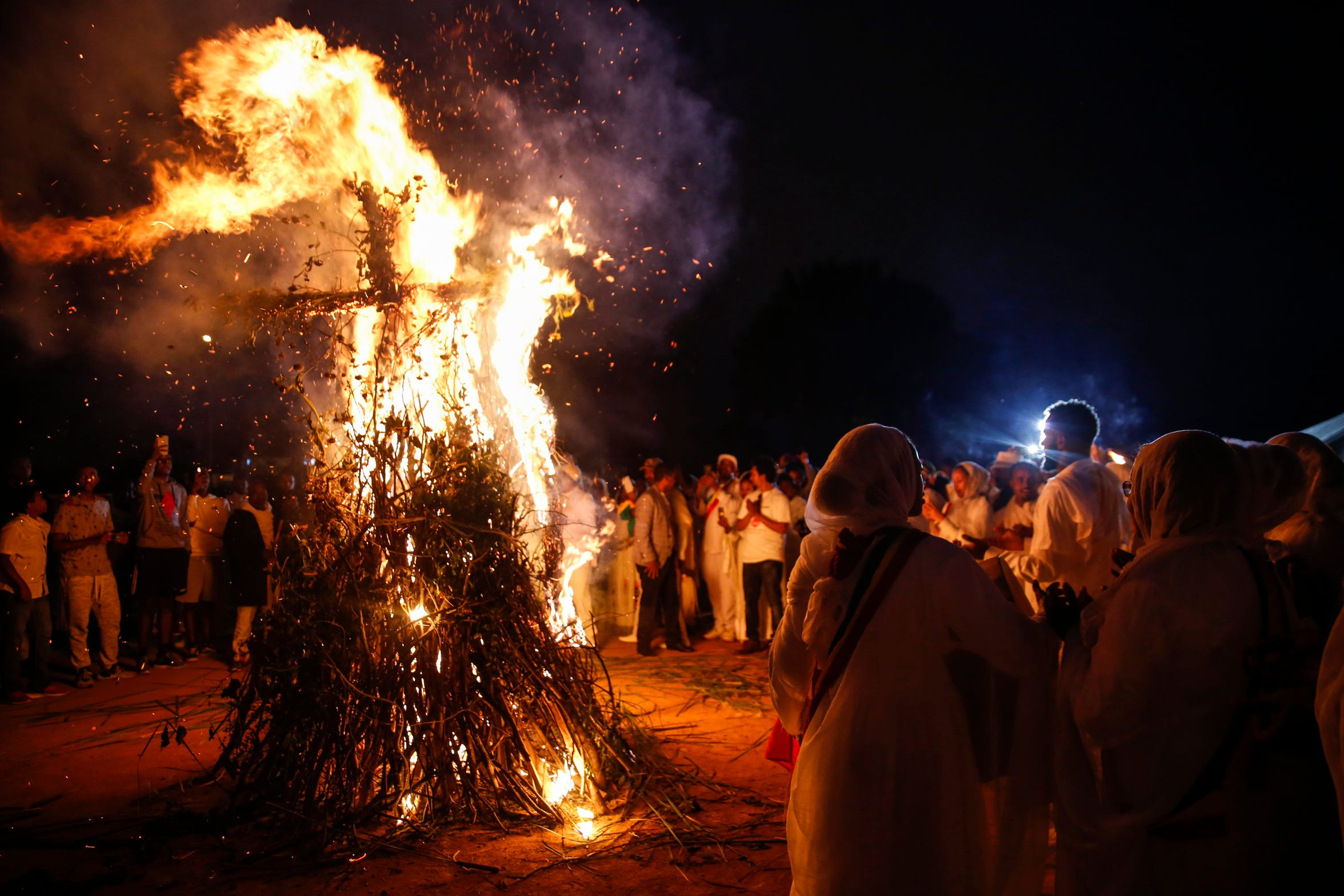A fire shaped like a cross is burned during the Meskel celebration on Sunday, Sept. 29, 2019 in Sioux Falls. Orthodox Christian Ethiopians celebrated Meskel, an annual holiday commemorating the discovery of the true cross.