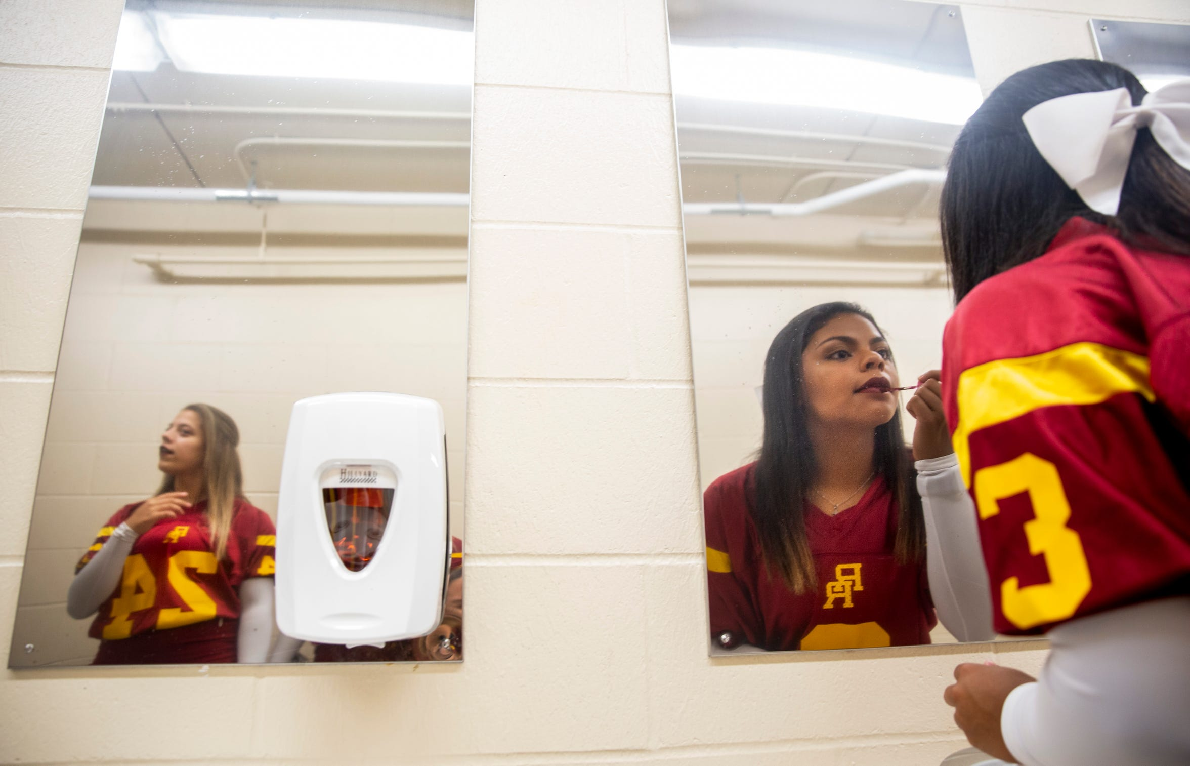 Roosevelt cheerleader Vell Dean (right) applies lipstick before the game on Friday, Sept. 6, 2019 at Howard Wood Field in Sioux Falls.