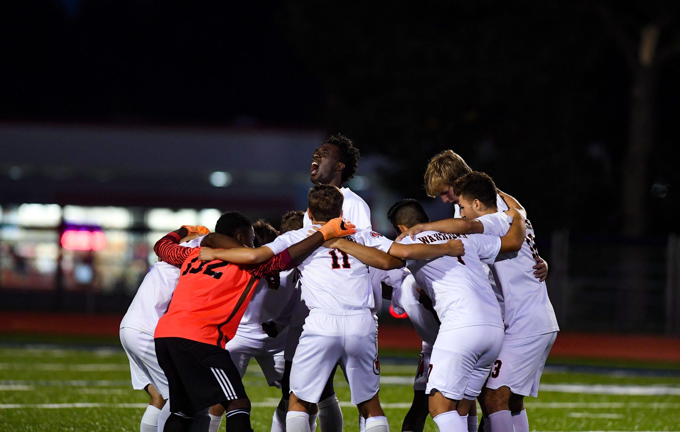 The Washington High School varsity boys soccer team amps up for a match Tuesday, September 17, 2019 at O'Gorman.