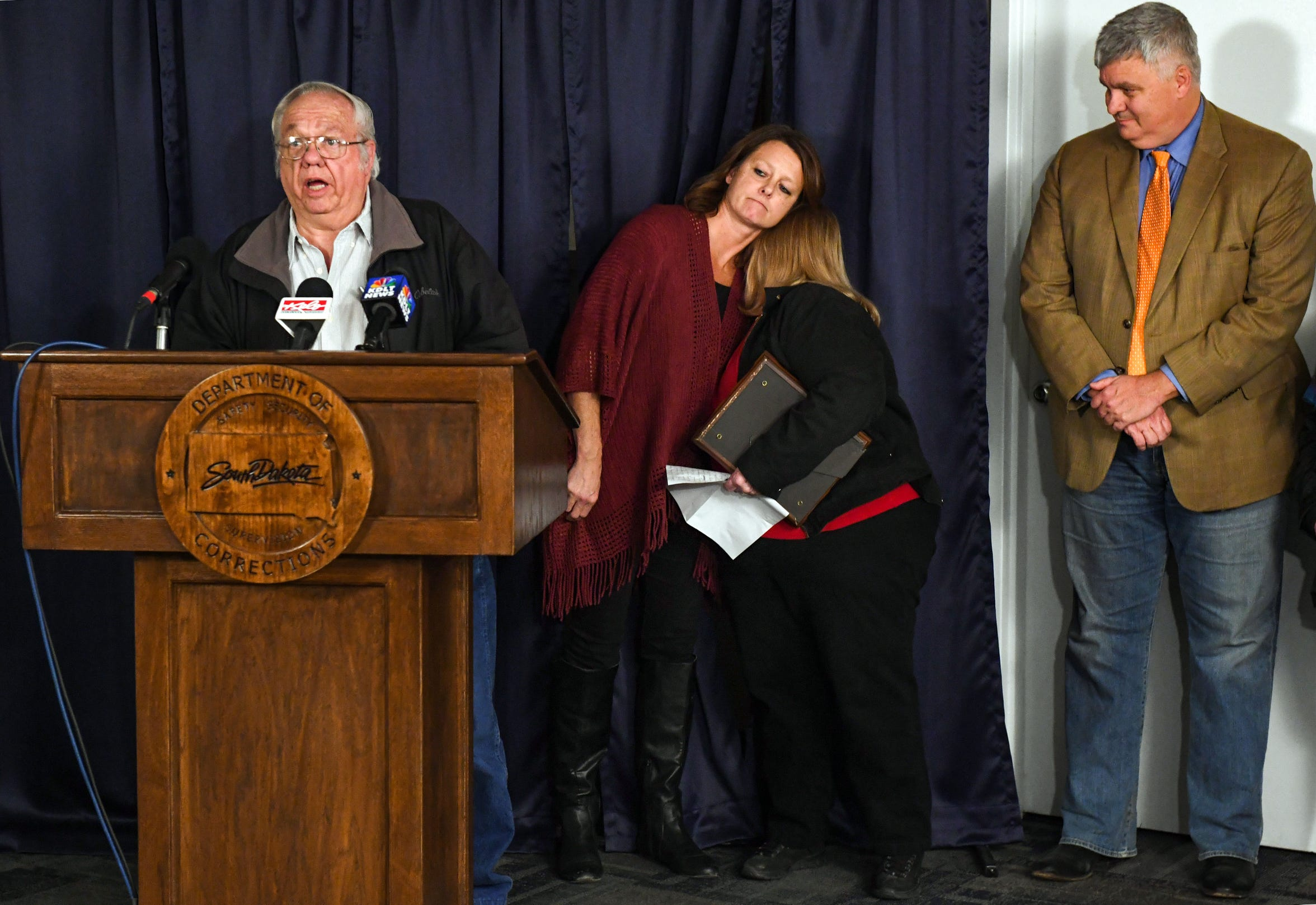 Ed Schaeffer, the father of victim Donnivan, speaks following the execution of Charles Rhines while mother Peggy Schaeffer hugs Sheila Pond Jackson, Donnivan's former fiancee, Monday, November 4, 2019 at the South Dakota State Penitentiary in Sioux Falls.