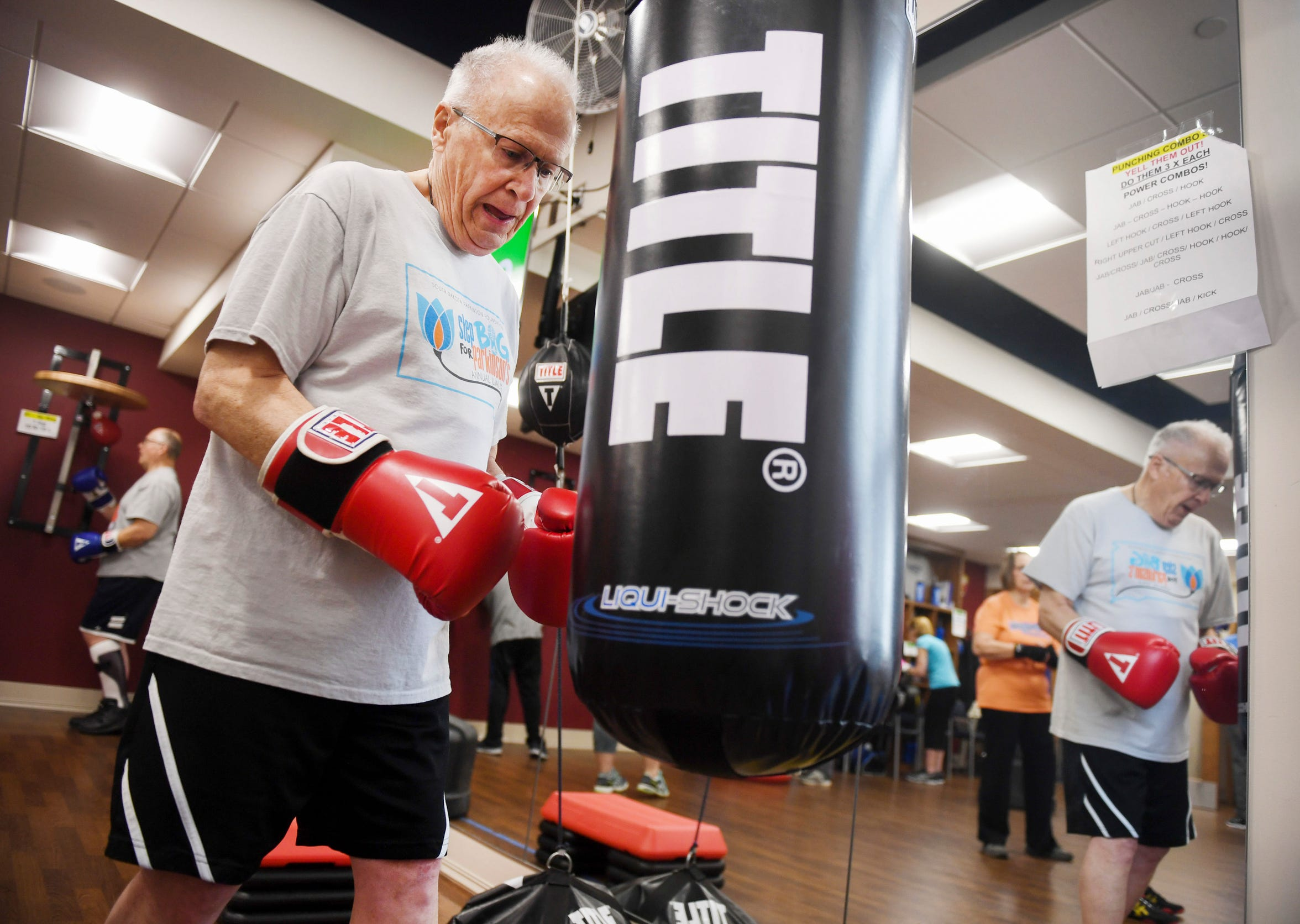 Allen Bindert, boxing name Right Hook Allen, hits the punching bag in the Rock Steady Boxing class Wednesday, April 3, 2019 with instructor Lisa Howard at The Inn on Westport in Sioux Falls. The program was designed to help people with Parkinson's disease.