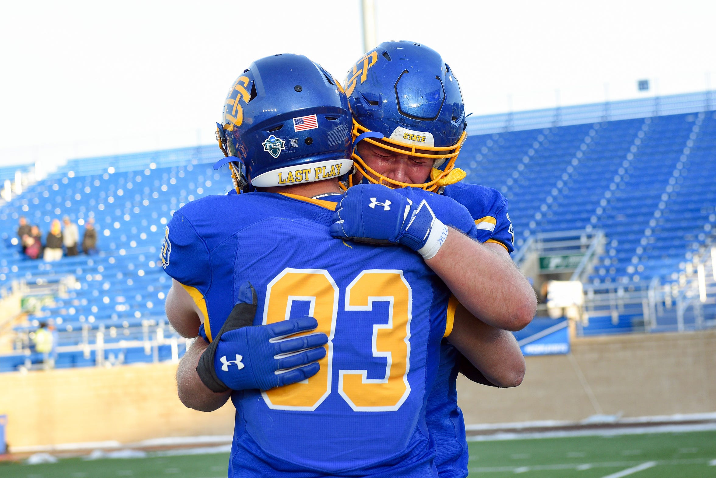 SDSU players cry into each other's shoulders after losing a playoff game on Saturday, Dec. 7, 2019 at Dana J. Dykehouse Stadium in Brookings.