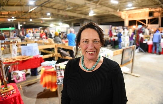 Sprout executive director Arlene Jones takes a second to smile for a photograph during the Growers and Makers Marketplace event Saturday, Dec. 14, at the food hub in Little Falls.