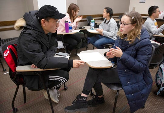 University of Minnesota freshman Chris Zhang and Hazel Holmdahl, 14, talk about schools while speaking in Mandarin Chinese on Thursday, Nov. 7, 2019 in St. Paul. A university program pairs high school students, who've been lifelong learners of Chinese, with Chinese students at the U. (Christine T. Nguyen/Minnesota Public Radio via AP)
