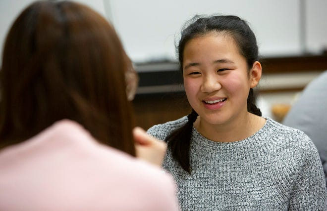 From right, Jing Jing Munson, 16, speaks with University of Minnesota graduate student Junyuan Xue, 25, on Thursday, Nov. 7, 2019. The program gives American high school students a chance to practice their Mandarin Chinese, while Chinese U of M students practice their English. (Christine T. Nguyen/Minnesota Public Radio via AP)