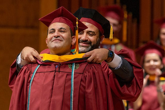 Tamer Tadros is hooded during Saturday's FSU graduation ceremony.
