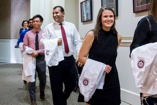 Tamer Tadros, in white shirt and red tie, during the PA Class of 2019 White Coat Ceremony in January, 2018 at Florida State University College of Medicine.