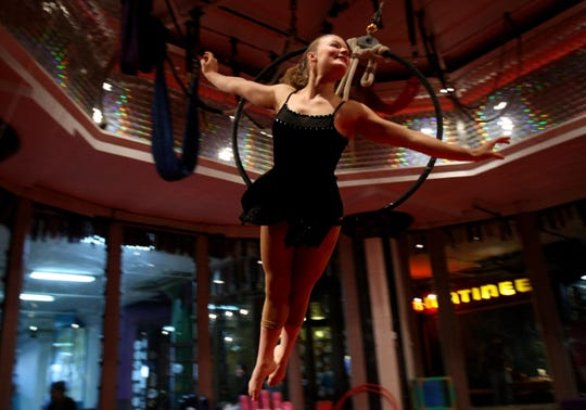 Claire Kuciejczyk, 17, performs Dec. 6, 2008, at the City Museum in St. Louis. The circus school run out of the museum brings together children who normally wouldn't cross paths and unifies them through circus training and performances.