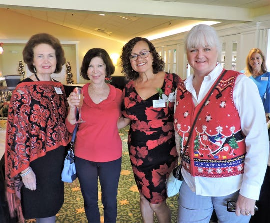 Betty Mulligan, left, Jill Preston, Event Chair Cecilia Lewis, and Cookie Contest Judge Katherine Bauman at the 4Cs Christmas Cookie Competition & Luncheon at Mariner Sands Country Club in Stuart.