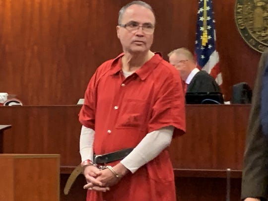 Murder suspect Asbury Perkins, 61, enters court Dec. 16, 2019 at the Indian River County Courthouse ahead of hearing seeking a judge's ruling to throw out statements he made to law enforcement Nov. 3, 2015, the night authorities found his ex-wife Cynthia Betts shot to death inside her Vero Beach home.