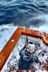 Fred Hardwick, angler on team Showtime!, reels in a sailfish Dec. 13 offshore of Stuart.