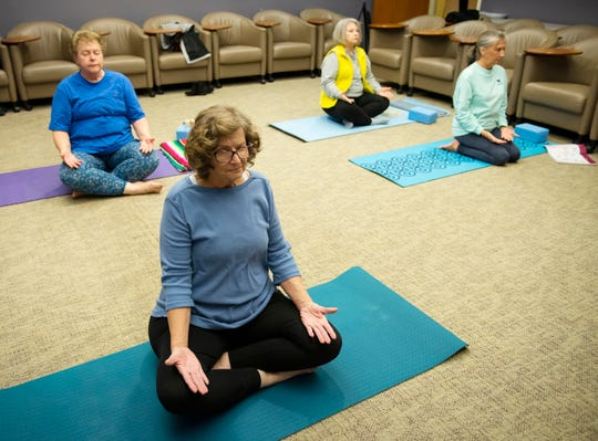 Women participate in a Yoga for Cancer Patients & Survivors class in the Bearden-Josey Center for Breast Health, a part of the Spartanburg Regional Healthcare System.
