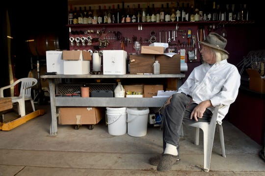 Artist turned winemaker Bruce Freeman sits in front of the Clos des Amis winery, which he runs with life partner Gretel Compton.