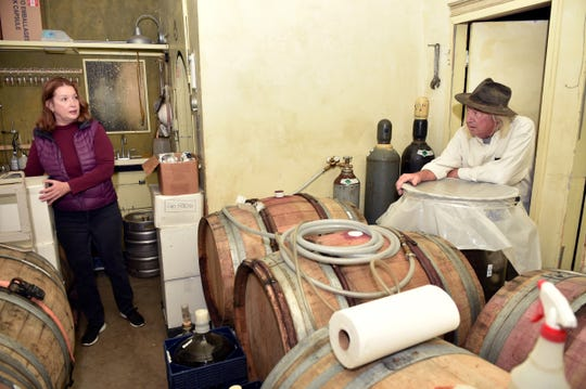 Life and winemaking partners Gretel Compton, left, and Bruce Freeman confer during a work session at Clos des Amis, their limited-production winery in Santa Paula.
