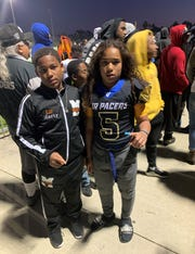 Millville Thunder RB/LB Shermar Collins Jr. (left) exchanged phone numbers with his opposite number on the Grant Junior Pacers Midget football team. The two teams faced off over the weekend in California at the 2019 Snooper Bowl.""