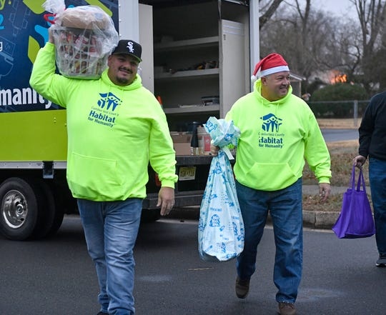 Cumberland County Habitat For Humanity partnered with the Malcolm Jenkins Foundation and delivered food baskets and gifts to a Vineland family on Monday, Dec. 16, 2019.