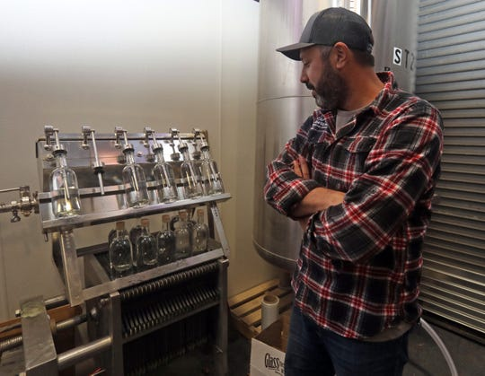 Scott Vaccaro, the owner and founder of Captain Lawrence looks at new bottles of spirits being bottled in Elmsford Dec. 12, 2019.