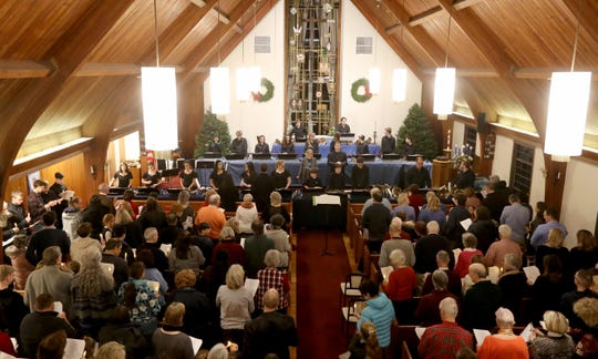 Parishioners fill the pews during a service and handbell benefit concert at Emanuel Lutheran Church in Pleasantville Dec. 15, 2019. Houses of worship throughout Pleasantville held services as part of a community wide vigil after a murder-suicide took the lives of the Liu family last week.