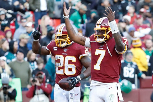 Dec 15, 2019; Landover, MD, USA; Washington Redskins running back Adrian Peterson (26) celebrates with Washington Redskins quarterback Dwayne Haskins (7) after scoring a touchdown against the Philadelphia Eagles in the fourth quarter at FedExField. Mandatory Credit: Geoff Burke-USA TODAY Sports
