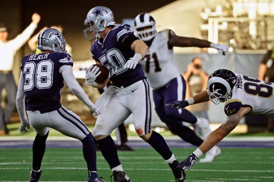 Dallas Cowboys outside linebacker Sean Lee (50) intercepts the ball in front of Los Angeles Rams offensive tackle Bobby Evans (71) and tight end Tyler Higbee (89) in the first half of an NFL football game in Arlington, Texas, Sunday, Dec. 15, 2019. (AP Photo/Roger Steinman)