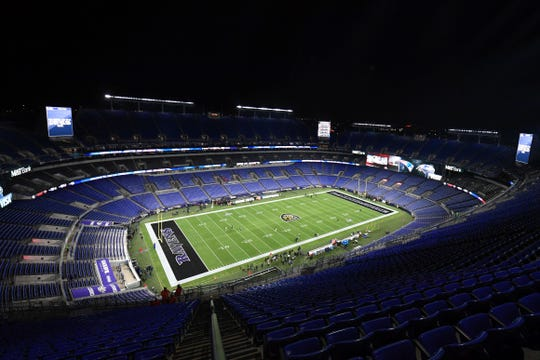 Police found a dead man in a port-a-potty at an M&T Bank Stadium parking lot.