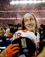 """Sunshine in California"" - Clemson quarterback Trevor Lawrence (16) celebrates beating Alabama 44-16 after the College Football Championship game at Levi's Stadium in Santa Clara, California Monday, January 7, 2019."