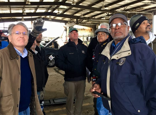 Gov. John Bel Edwards (center) tours the Rapides Parish Highway Department facility on Louisiana Highway 28 West Tuesday. The facility was one of the hardest hit by a tornado Dec. 16, 2019.