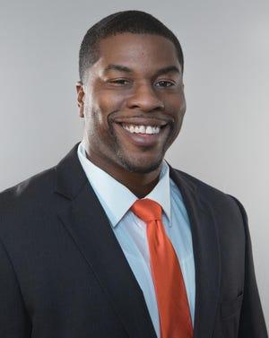 Tony Aker is the new head football coach at Lawrence University.