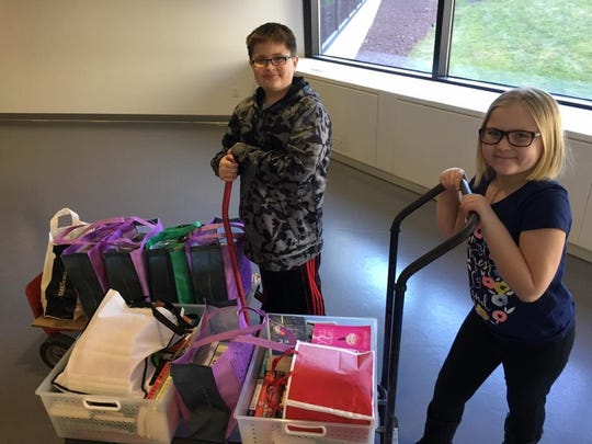 In 2017, Eddie and Alison Bonk deliver donations to a book drive.