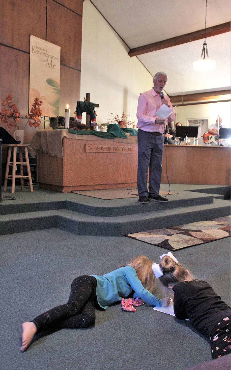 There is no rule at Wylie Christian Church that you have to stay in your seat. Youngsters color and roll around almost at the feet of the preacher, Doug Roysden.