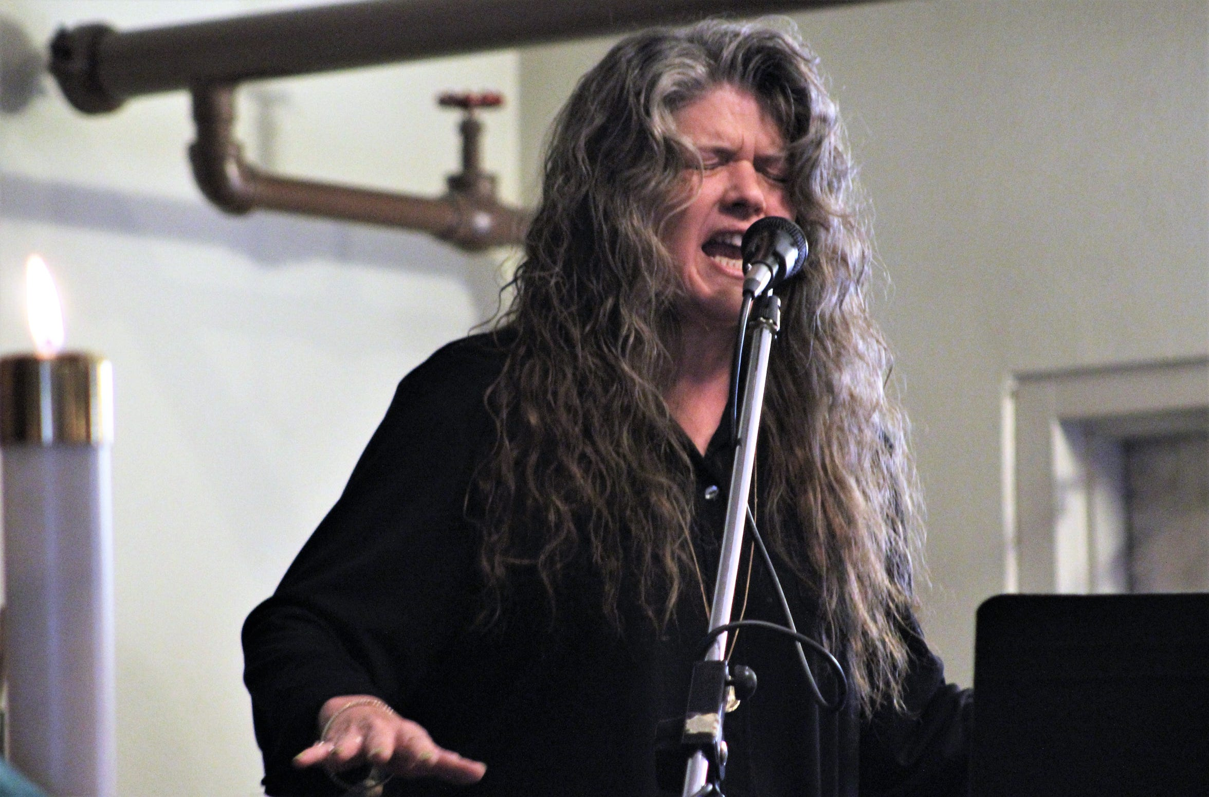 Shannon Roysden puts emotion into her singing with the Red Dirt Disciples, the praise band tucked away in a corner under pipes at Wylie Christian Church. Nov. 10 2019