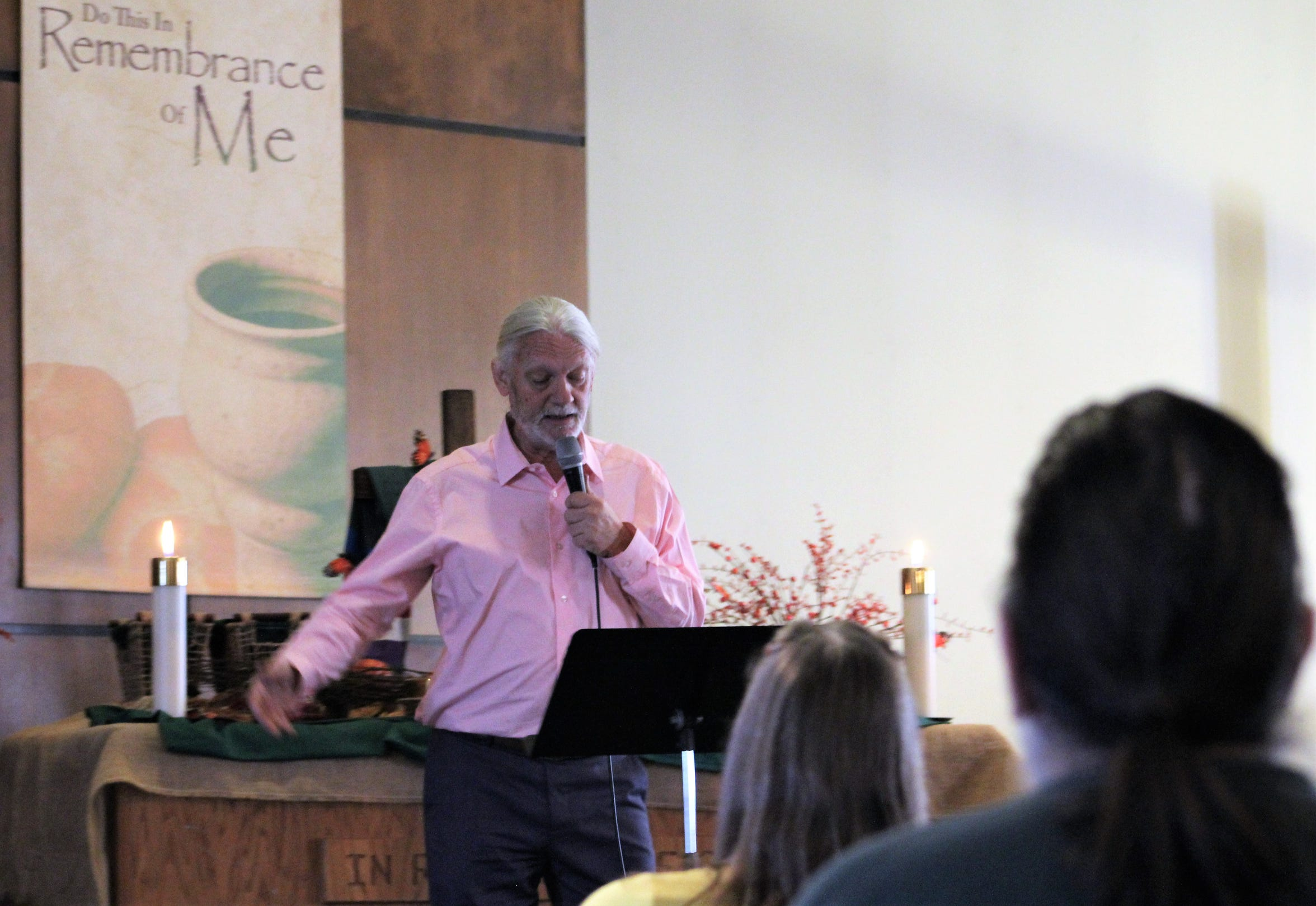 Using a music stand as a lectern, Doug Roysden delivers his message one recent Sunday at Wylie Christian Church, where the roots rock band leader has pastored for 18 years.