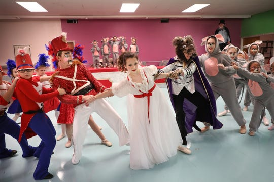 "The casts rehearses the battle scene in ""The Nutcracker"" by Dance Ltd."