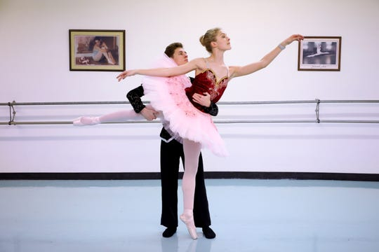 "Lorenzo Tibbitts and RaeLeigh Taylor rehearse a scene in ""The Nutcracker."""