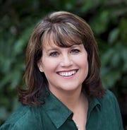 Gina Collias, a Democrat, of Fairview
