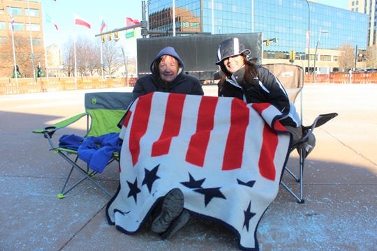 Saundra Kiczenski, left, and Judy Chiodo starting waiting outside of Kellogg Arena a day in advance of President Donald Trump's campaign rally in Battle Creek.