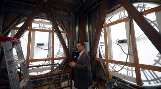 Port Orchard Mayor Rob Putaansuu gives a tour of the clock tower atop Port Orchard City Hall on Dec. 16.