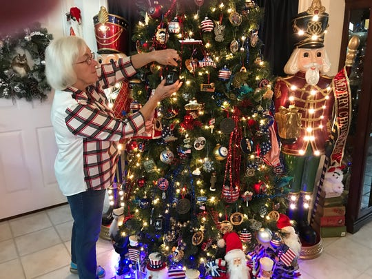Louise Carnesale of Indian River Colony Club is full of good patriotic cheer with her Christmas tree.