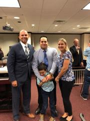 Jonathan Pogar, son Andrew and wife Heather, pose with State Rep. Rene Plasencia at a Dec. 11 subcommittee hearing on H.B. 575, which would allow RBTs into Florida schools.