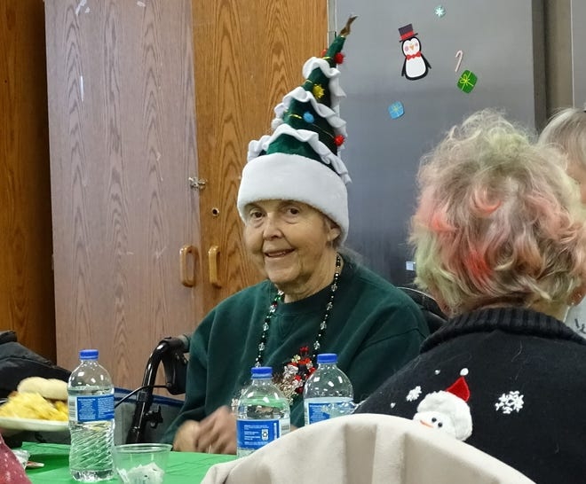 Marilyn Smith sports a Christmas tree hat at the annual Christmas party at the Crawford County Council on Aging.