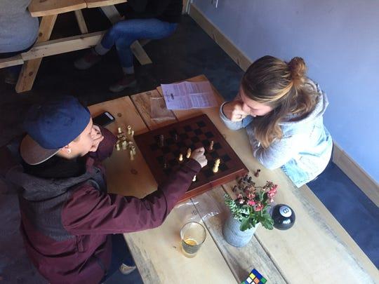 Amanda Kulas, left, and Sam Wegiel of Windsor Locks, Connecticut, play chess Nov. 30, 2019 at Snow Republic Brewing Co. in West Dover.