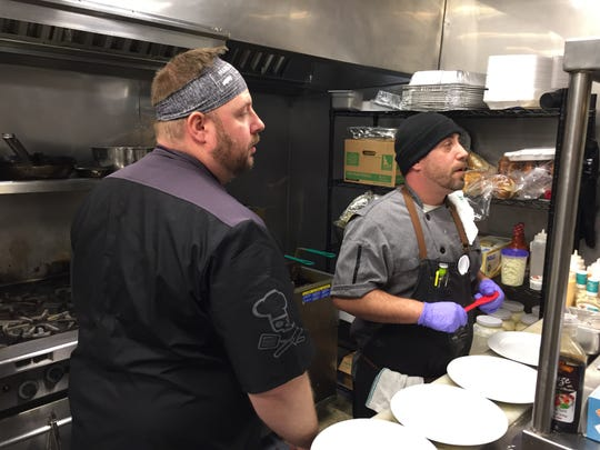 Darrell Langworthy, owner of Heart n Soul, and chef d'cuisine Shaun Trepanier work in the kitchen at the Essex Junction restaurant Dec. 13, 2019.