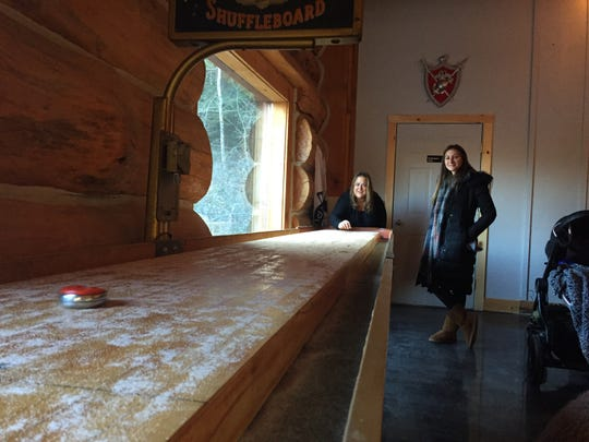 Paulette Perry, left, and Jamie Gardner, both of New York, play shuffleboard at Snow Republic Brewing Co. in West Dover on Nov. 30, 2019.