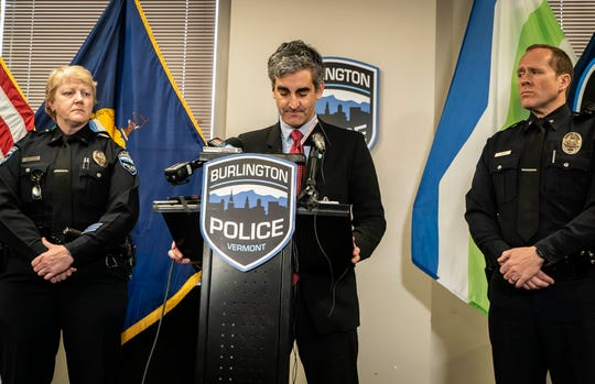 From left, Burlington Police Department Deputy Chief Jan Wright listens to Mayor Miro Weinberger announce the resignation of Chief Brandon del Pozo on Dec. 16, 2019, after revelations that he created a fake Twitter account and harassed a city resident. Deputy Chief Jon Murad, right, was named Acting Chief after Wright admitted that she used a fake Facebook account.
