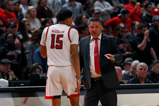 Texas Tech coach Chris Beard talks to Kevin McCullar (15) during the second half of an NCAA college basketball game against Southern Mississippi, Monday, Dec. 16, 2019, in Lubbock, Texas. (AP Photo/Brad Tollefson)
