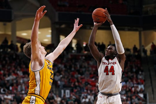 Texas Tech's Chris Clarke (44) shoots the ball over Southern Mississippi's Hunter Dean (20) during the second half of an NCAA college basketball game Monday, Dec. 16, 2019, in Lubbock, Texas. (AP Photo/Brad Tollefson)