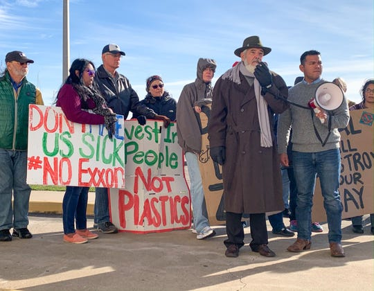 Errol Summerlin, front left, and Eric Rodriguez, front right, speak during a protest opposing desalination plans on Tuesday. Rodriguez is the Coastal Bend Sierra Club chairman and Summerlin is a member of the Coastal Alliance to Protect our Environment.